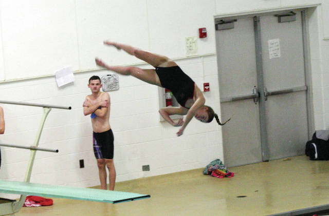 Wauseon's Kennedy Nation with one of her dives during a meet Tuesday at home against Bryan and Springfield. She posted a score of 193.75 to win the girls diving competition.