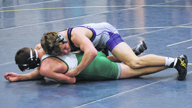 Swanton's Chase Moore, top, holds down Max Hoffman of Delta at 152 pounds Wednesday at Archbold. The Bulldogs won duals over Montpelier and Delta to advance to the regional semifinal of the state dual tournament.