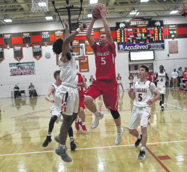 Levi Seiler of Wauseon goes up strong and scores over a Southview defender Saturday in a non-league contest. The Indians stayed unbeaten with a 48-43 triumph over the Cougars.