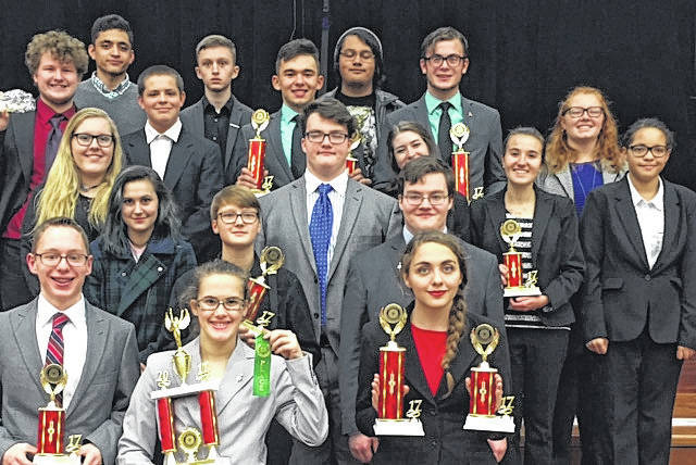 The Wauseon Speech and Debate team shows off trophies earned this season.