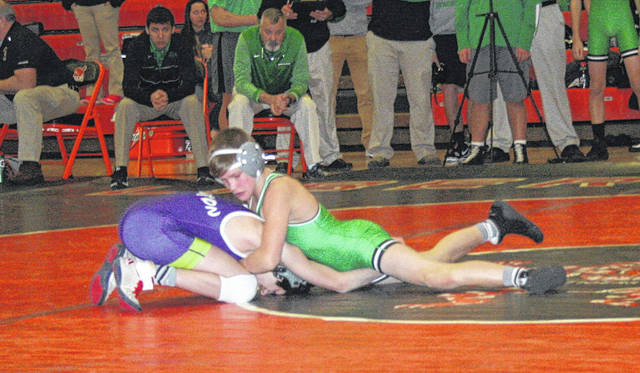 Zack Mattin of Delta, right, wrestles in the 106-pound match Thursday against Swanton in a quad at Liberty Center. He earned a pin in the match, but the Panthers were defeated by the Bulldogs 54-27.