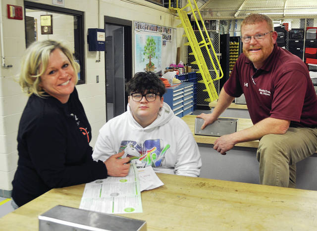 Four County Career Center recently hosted a Career Night Open House with labs and classrooms open to the public. Instructors and counselors were available to answer questions and acquaint visitors with career and technical programs and college credit options. Shown talking about the electrical program are, from left, Michelle Black and Michael Dymarkowski from the Evergreen school district with instructor Scott Williams.
