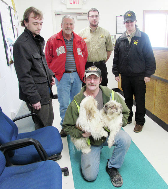 Pictured with Robert Browning, who is holding Zak and Timber, are, from left, Allen Browning, Steve Wanner, Jon Rufenacht, and Courtney Iwinski.