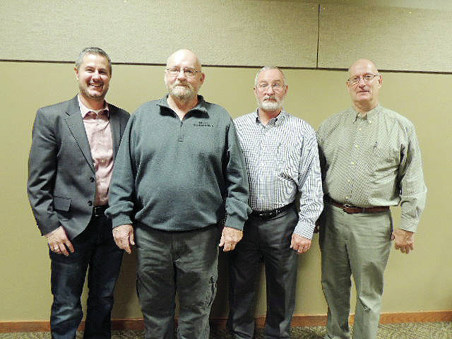 Service awards were given at the Christmas party held for employees of Grieser Transportation in Wauseon. Shown are, from left, Jason Grieser, President; JB Stevens a 10-year award recipient; Sam Flynn, a 15-year award recipient; and Dave Grieser, Vice-President.