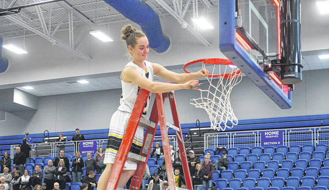 Elizabeth Beck of Pettisville helps cut down the net Saturday after the Blackbirds defeated Antwerp to win a Division IV sectional championship. Her three second half treys helped lift the Blackbirds to victory.