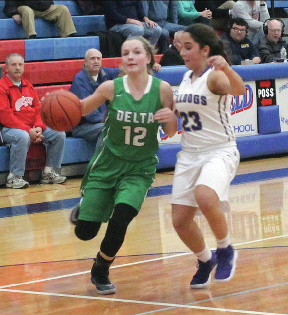 Brooklyn Wymer of Delta drives toward the basket as Averie Lutz of Swanton defends on Saturday in the sectional final.