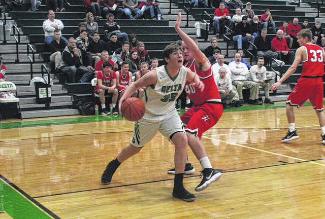 Seth Burres of Delta drives along the baseline Tuesday against Hilltop. The Panthers fell to the Cadets 65-58.