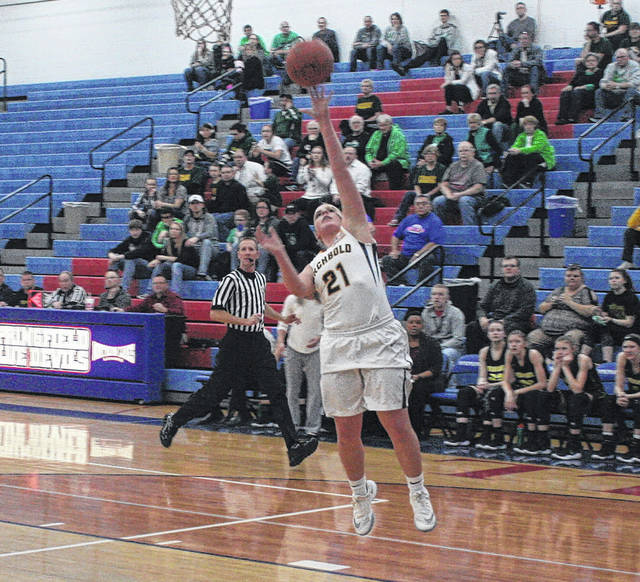 Emie Peterson of Archbold with a basket off a steal Tuesday in the Division III sectional semifinal against Evergreen. She had 11 points for the Blue Streaks as they defeated their league rivals, 50-23.