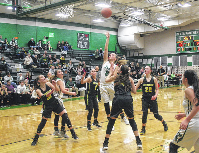 Abby Freeman of Delta, center, puts one in the hoop for the Panthers in a NWOAL game against Evergreen Thursday. The Panthers improved to 5-0 in the league with a 47-42 win over the Vikings.
