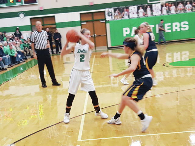 Delta's Abby Freeman looks for space to shoot Thursday against Archbold in a game that decided the NWOAL championship. Freeman led the way for the Panthers with 27 points as they defeated the Blue Streaks 65-40.