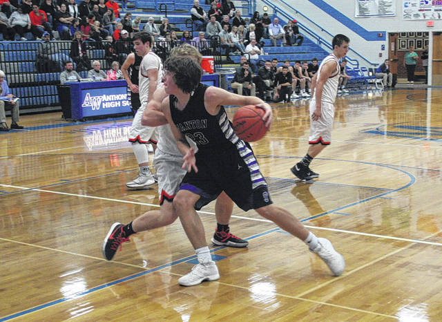 Swanton's Andrew Thornton posts up Tuesday in a Division III sectional semifinal against Liberty Center. He made some key plays down the stretch to help the Bulldogs come away with a 48-41 win.