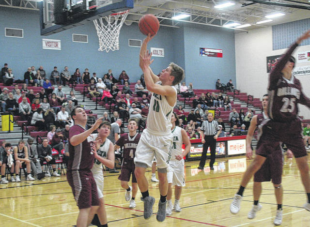 Gabe Freeman of Delta scores in the second quarter Wednesday versus Rossford in a Division III sectional semifinal. The Panthers fell to the Bulldogs, 40-31.