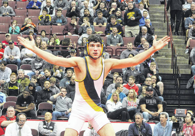 Gavin Grime of Archbold celebrates after defeating Conan Becker of Galion Northmor 3-2 to win the Division III 145-pound state title Saturday night at the Schottenstein Center in Columbus.