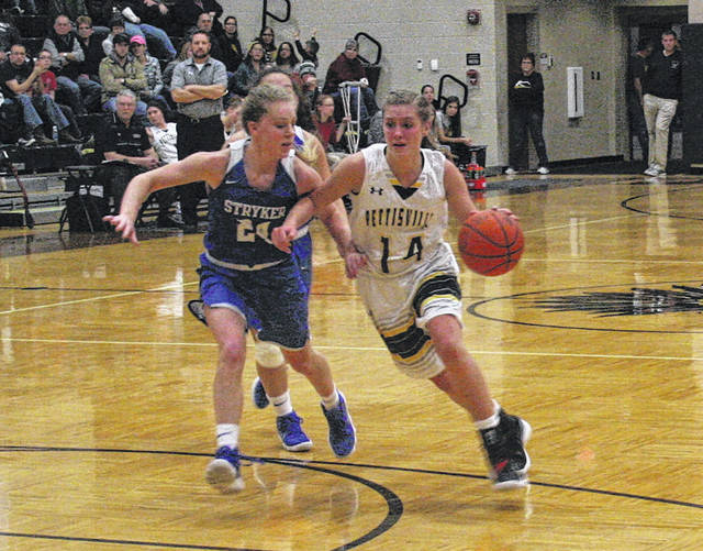 Morgan Leppelmeier of Pettisville, right, drives to the hoop in a Buckeye Border Conference game versus Stryker this season. The junior was named the player of the year in the league.