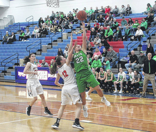 Maddie Mattimore of Delta scores in a sectional tournament game this season. Earlier this week, she was selected second team All-Ohio in Division III.