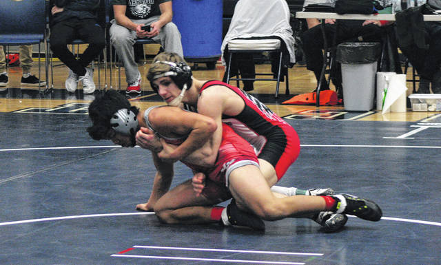Nolan Ray of Wauseon, right, wrestles at the Division II sectional tournament at Napoleon a few weeks ago. Fresh off a district championship this past weekend, Ray will represent the Indians at the state meet which begins Thursday in Columbus.