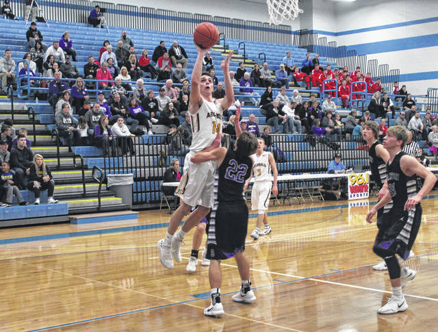 Austin Wiemken of Archbold scores inside Friday against Swanton in a Division III sectional final. He finished with a game high 24 points.