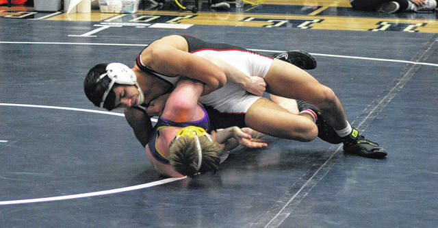 Wauseon's Hunter Yackee, top, competes at the sectional wrestling tournament in Napoleon last weekend. He was 1 of 9 Indians to advance to state out of the Division II district tournament at Defiance Saturday.