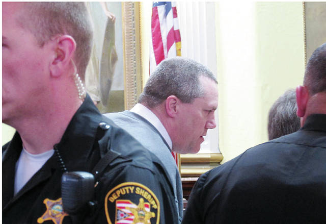 James Worley was surrounded by Fulton County Sheriff's deputies following the hearing.