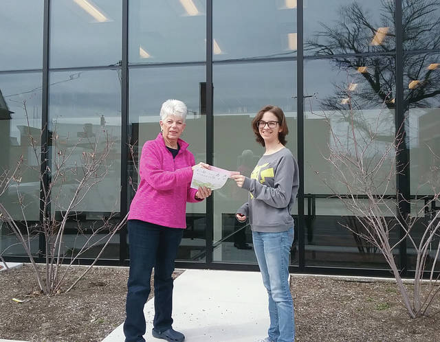 The Wauseon Public Library has selected Caitlyn Robertson as the winner for the Window Art Contest. She is the daughter of Chris and Melissa Robertson. There were four entries and the winner was selected by Mrs. Norma Thomas Herr and Mrs. Judy Kahle. Robertson was awarded $500. The art work has been sent to Auto Trim from Adrian, Mich. and will be installed as soon as possible. The Board of Trustees were very pleased with all the artwork that was submitted and thank the other three entrants for their submissions. Pictured are Sara Short, Board Vice-President, and Caitlyn Robertson, right.