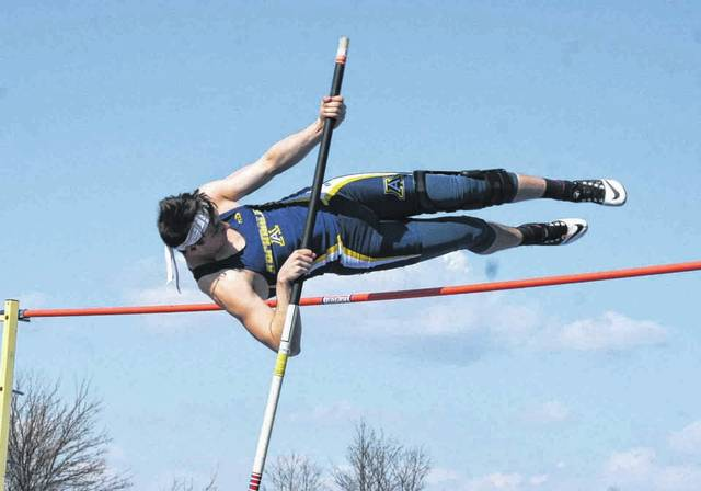 Shane Bechtel of Archbold competes in the pole vault during the Walker/Dilbone Relays Friday. He finished third as an individual after clearing 11 feet, 6 inches.