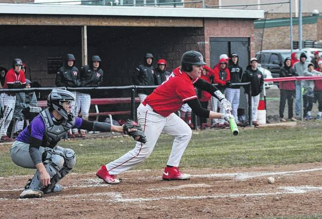 CJ Moser executes a bunt for Wauseon in the bottom of the third inning against Swanton Monday in NWOAL baseball. The Indians outlasted the Bulldogs in ten innings, 6-5.