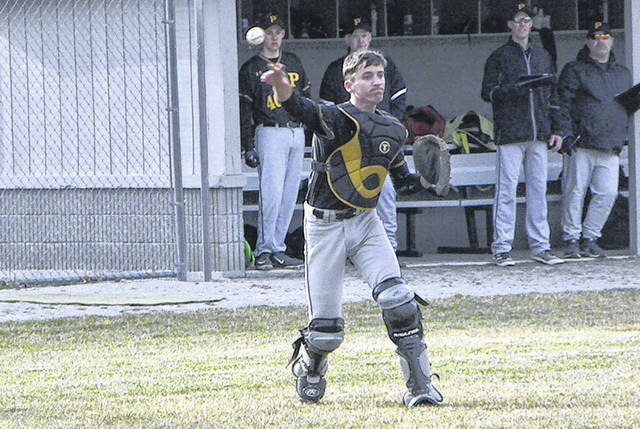 Pettisville catcher Justin Rupp fields a ball and throws to first for an out Monday against North Central. However, the Blackbirds came up short against the Eagles 10-2.