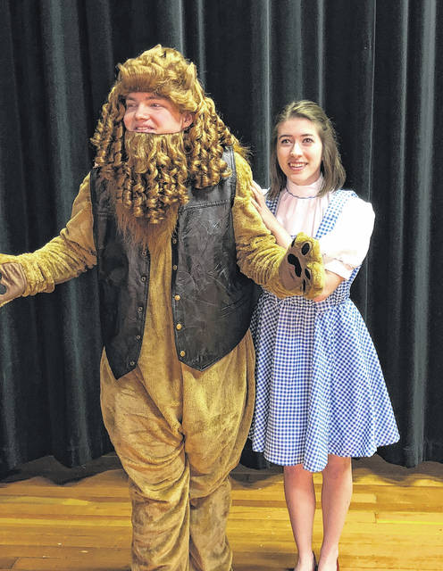 """Paige Moden, Dorothy, and Hunter Mattin rehearse for Wauseon's production of """"The Wiz."""""""