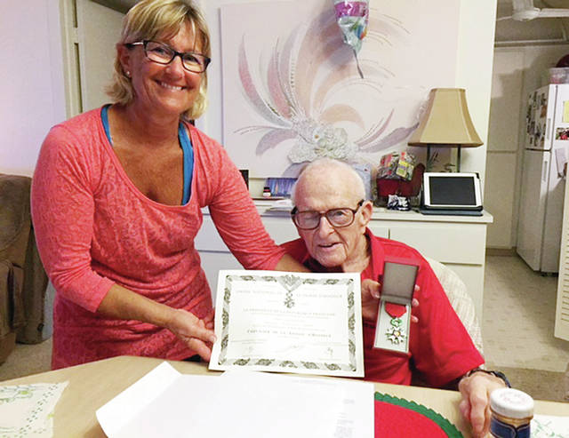 Dr. Frederick Flory poses with his French Legion of Honor medal with his daughter, Annette Saylor.