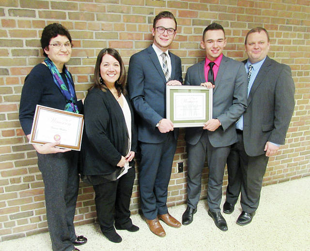 Wauseon High School Speech and Debate Team members Colton Blanton, center, and Christian Cantu, second from right, hold a proclamation awarded by Wauseon Mayor Kathy Huner, second from left, to recognize their state championship win in the Speech Duo Interpretation Team category of the Ohio Speech and Debate Association's state finals March 2-3 in Sylvania. WHS Speech and Debate head coach Dolores Muller, far left, was also recognized for her entry into the association's Hall of Fame. Pictured far right is Jason Robinson, assistant coach.