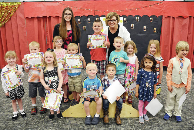 The students at Four County Career Center's Early Childhood Education class recently held preschool graduation for children enrolled during the 2017-18 school year. The children performed favorite songs and fingerplays learned throughout the school year for parents and grandparents in attendance. Pictured are - front, from left - Isabella Schoonover of Defiance, Zachary Norden of Napoleon), Zane Reed of Napoleon, Giuliana Zetter of Toledo - middle, from left - Audrey Brywczynski of Whitehouse, Jordan Inkrott of Delta, Jayden Elmer of Helena, Micah Helberg of Napoleon, Stryker Oyer of Napoleon, Brennan Vandock of Delta, Elowyn Custer of Wauseon, Sylvie Zartman of Antwerp, Malcolm Custer of Wauseon - back, from left - preschool instructor Katelyn Flanary, and educational aide Jennifer Hutchison. The Preschool/Childcare Center is operated in association with the Early Childhood Education program for juniors and seniors as a part of their lab experience. Supervising the students is instructor, Susan Myers.