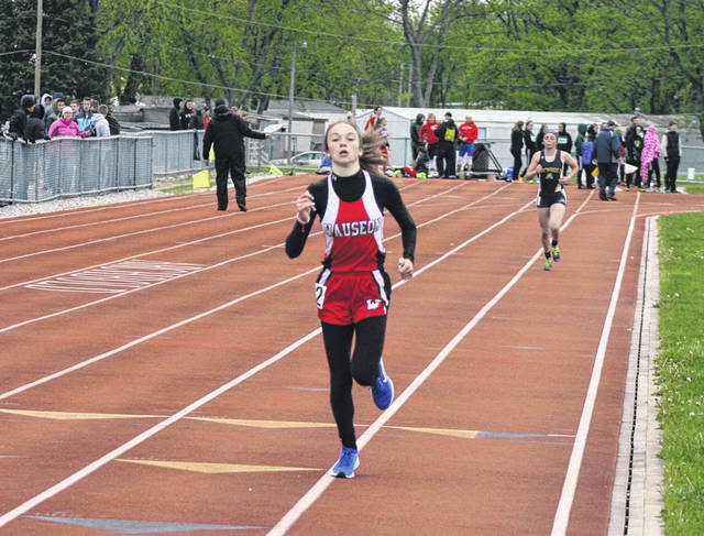 Samantha Aeschliman of Wauseon trots to the finish in the 1600 meter run Friday during the NWOAL meet. She took first in this event and also the 3200m, helping the Wauseon girls take second as a team.