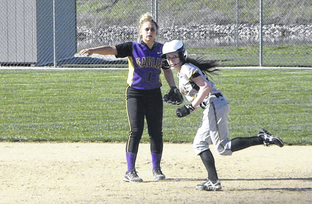 Pettisville's Kyra Behnfeldt, right, rounds second as Fayette's Bailee Smith watches a play at first base after a throw during Monday's Division IV sectional semifinal. Behnfeldt's two-run double in the bottom of the sixth helped lift the Blackbirds to a 6-5 win.