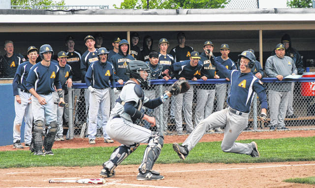 Bryce Williams of Archbold slides home ahead of a tag as part of a two-run fifth Friday against Lake in a Division III sectional final. The Bluestreaks advanced with a 3-0 shutout win.