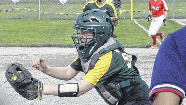 Evergreen catcher Grace Bryson awaits to tag a runner at home plate Monday against Eastwood in a Division III softball district semifinal. The Vikings were shut out by the Eagles 7-0.