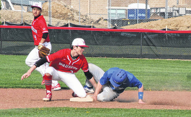 Wauseon shortstop Carter Stump tags out an Edon base runner attempting to steal during Friday's game. The Indians would defeat the Bombers by walkoff, 8-7.