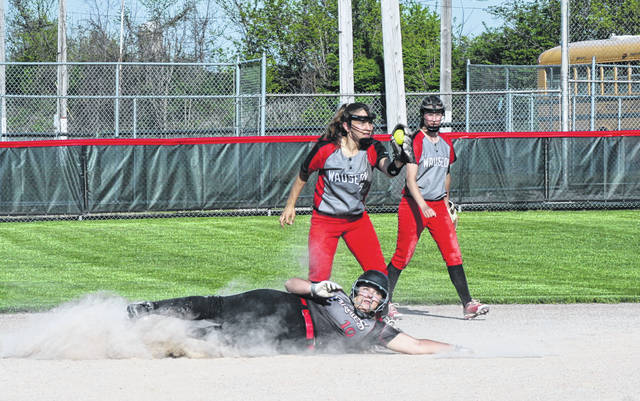 Wauseon's Ally Tefft shows the ball to the umpire after tagging out Karli Canterbury of Perkins (10) who was attempting to steal second during a Division II softball sectional semifinal Tuesday. The Indians advanced to the sectional final with a 9-2 win over the Pirates.