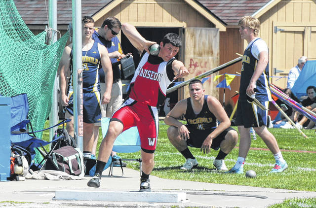 Kyle Zirkle sets to throw in the shot put at the NWOAL Track and Field Championships Tuesday. He won both the shot put and discus for the Indians.