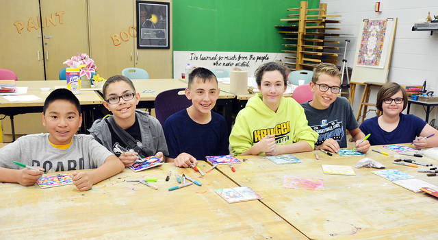 "Four County Career Center in Archbold sponsored a week-long Summer Camp for seventh, eighth, and ninth graders in the four-county area. Students had the opportunity to explore the areas of art, math, cooking, and the animal kingdom from experienced instructors. Shown doing hands-on learning in the ""Color Your World"" class are, from left, Ty Nofziger of Pettisville, Josiah Burks of Pettisville, Mason Stickley of Pettisville, Kate Krueger of Archbold, Cole Plassman of Archbold, and Josie Hite of Wauseon. Instructor for the class was Erin Custer."
