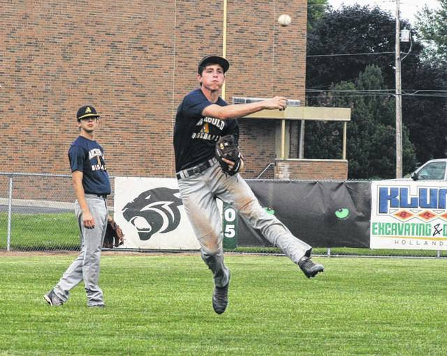 Archbold third baseman Clay Nafziger throws out a Delta base runner during an ACME baseball game Tuesday. The Bluestreaks bested the Panthers 17-1 in five innings.