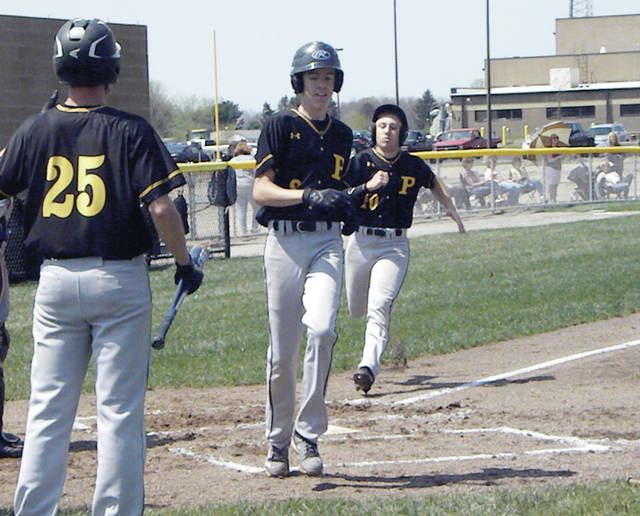 Logan Rufenacht of Pettisville scores ahead of teammate Austin Horning in a game versus Fayette this season. Rufenacht made second team all-league for the Blackbirds while Horning was honorable mention.