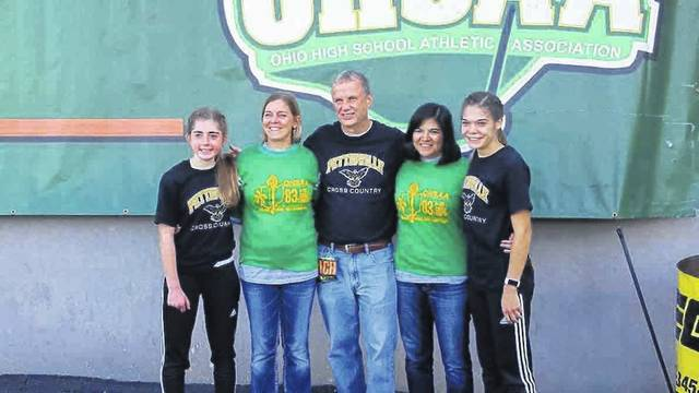 Pettisville cross country and track and field coach Tom Wagner with four of his athletes, past and present, at the OHSAA State Track and Field Championships earlier this month. Wagner stepped down after the school year. From left: Kate Stuber, Lori (Nofziger) Stuber, Wagner, Ezzie (Avina) Sauder, Elizabeth Sauder.