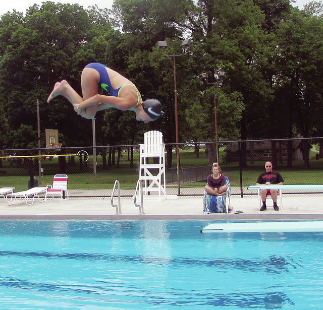 Bailey McGuire, a lifeguard for the new Wauseon pool, does a flip off the diving board during dive training.