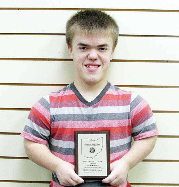 WHS student Matthew Manson holding his coveted Outstanding Citizen Award from Buckeye Boys State.