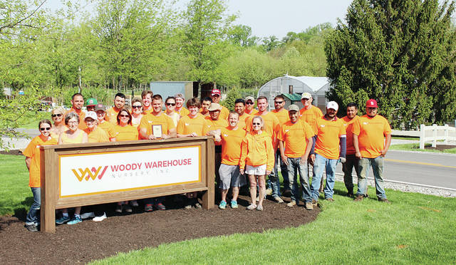 The City of Wauseon's Tree Commission recently awarded the Booster of the Year award to Woody Warehouse of Lizton, Ind. Woody Warehouse has been donating the large trees that have been planted at Wauseon schools for Arbor Day for many years. Each year they donate a different species of tree. This year, the schools received a River Birch and a Tulip tree.