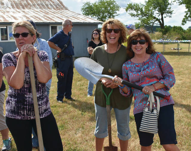Carol Creque, Deb Langenderfer, Laurie Gombash at the groundbreaking for The Farmhouse barn on Friday.