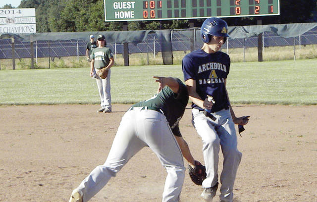 Archbold's Jeron Williams avoids a tag on a pickoff play at first base Friday versus Tinora in the District 2 ACME sectional tournament. The Bluestreaks dropped that contest against the Rams, but would defeat them two days later to punch their ticket to the district tournament.