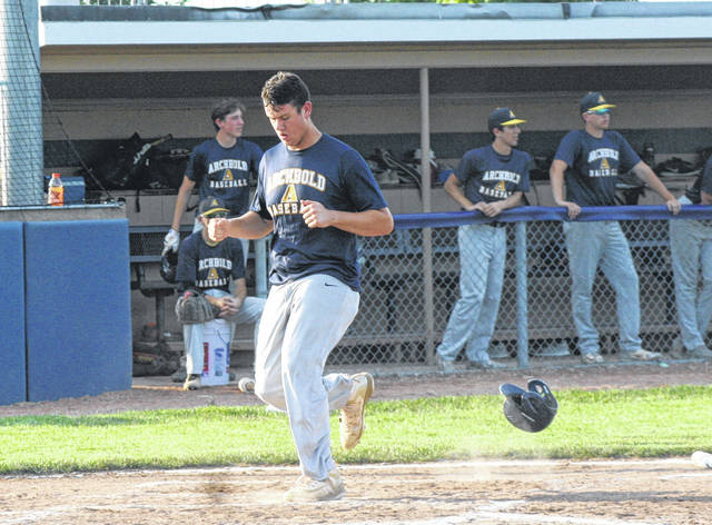 Drake Mohring scores Archbold's first run in the bottom of the second inning of a ACME baseball game against Bryan Thursday. The Bluestreaks fell to the Golden Bears 6-5.