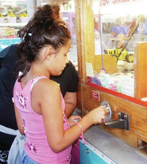 Amaya Miracola, 9, of Wauseon, tried her hand at the elusive crane game on the midway.