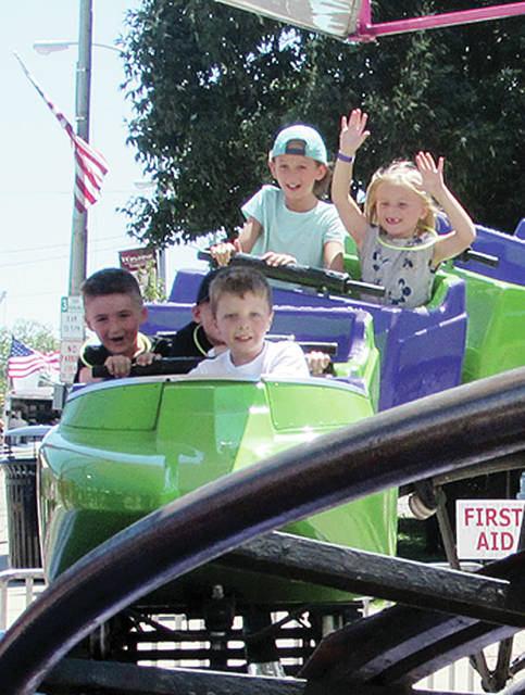 Kids ride a mini roller coaster at last year's Homecoming.